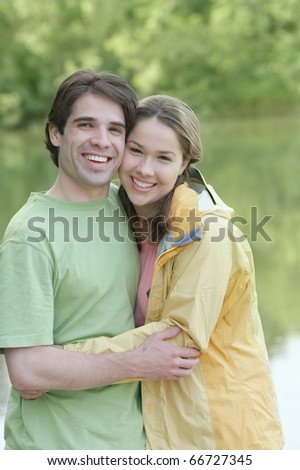 Young couple embracing outside