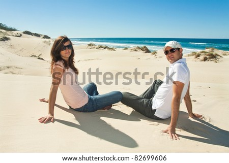 young couple enjoy beautiful day on the beach (gold coast,qld,australia)