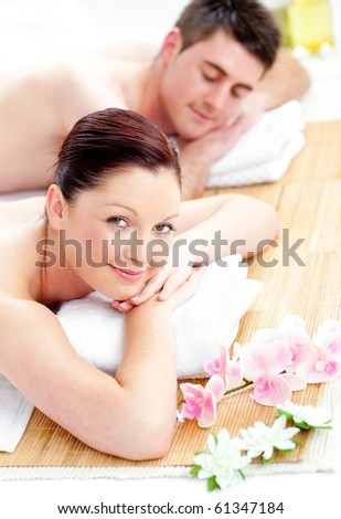 Young couple enjoying a back massage in a spa center