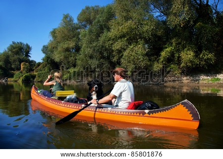 Young couple enjoying a trip in a canoe