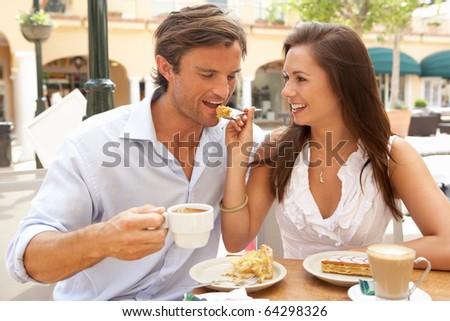 Young Couple Enjoying Coffee And Cake In Cafe #64298326