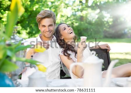 Young couple enjoying lunch in the garden
