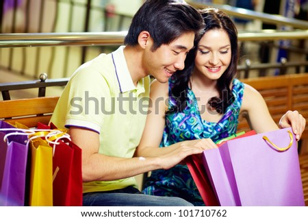 Young couple enjoying their purchases after a long shopping day