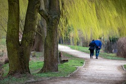 Young couple enjoying walking in the summer Park