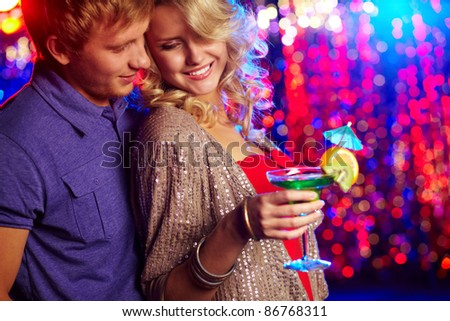 Young couple entertaining together at a party