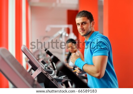 young couple exercising in the gym
