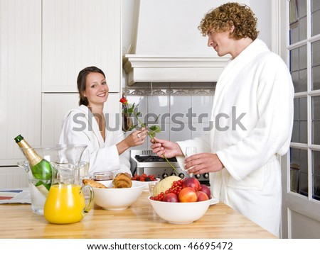 Young couple expressing their love at a valentines champagne breakfast