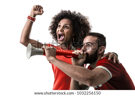 Young couple fan celebrating on red uniform - Shutterstock ID 1032256150