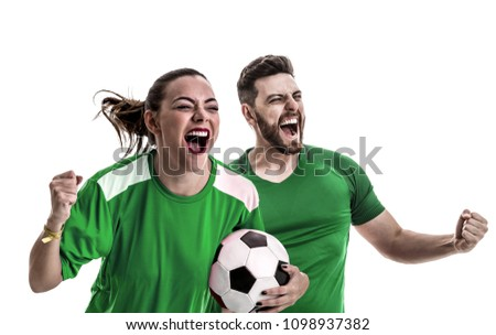 Young couple fan in green uniform celebrating #1098937382