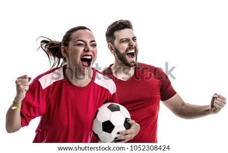 Young couple fan in red uniform celebrating - Shutterstock ID 1052308424
