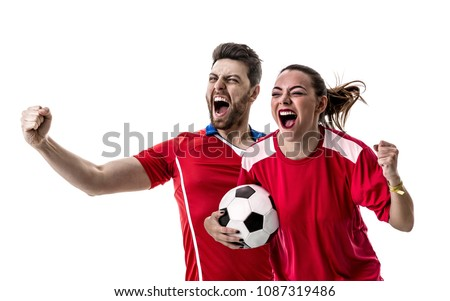 Young couple fan in red uniform celebrating #1087319486