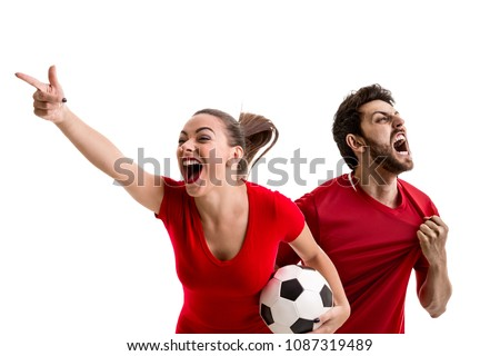 Young couple fan in red uniform celebrating #1087319489