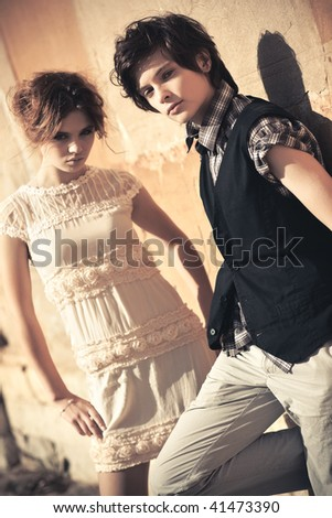 Young couple fashion. Soft yellow tint.
