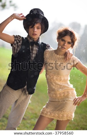 Young couple fashion. Standing at the rain.