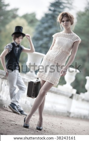 Young couple fashion. Young walking lady and gentleman.