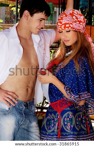 young couple flirting, outdoor shot