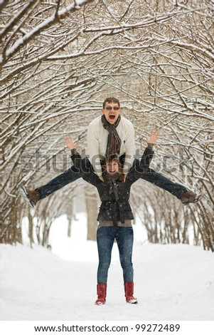 Young couple fooling around outdoors