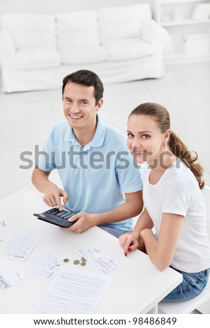 Young couple for the calculations at home
