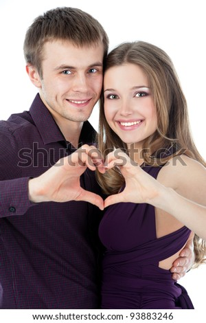 Young couple forming heart shape with their hands isolated on white background