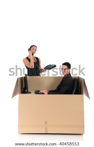 Young couple friends in chat box, cardboard box representing chat room.  Studio, white background