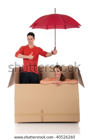 Young couple friends in chat box, safe supervised surfing, cardboard box representing chat room.  Studio, white background