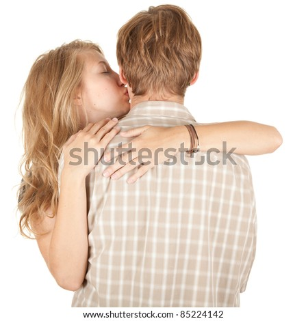 young couple - girl kissing his boyfriend, white background