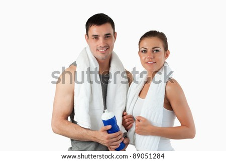 Young couple going to practice sport against a white background