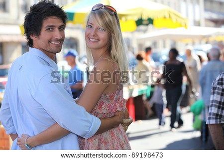 young couple going to the market