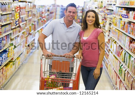 Young couple grocery shopping in supermarket