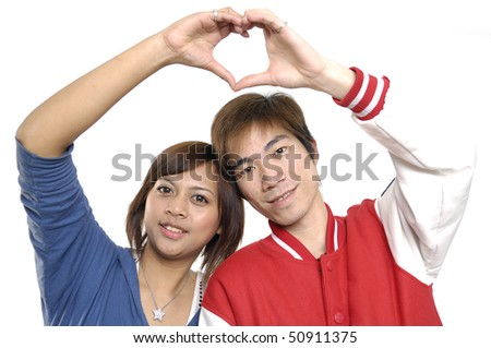Young couple hands making heart shape