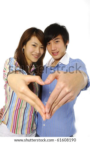 Young couple hands making heart shape-close up