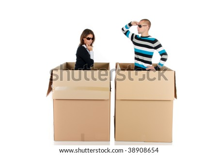 Young couple having a blind date, chat box, cardboard box representing chat room.  Studio, white background