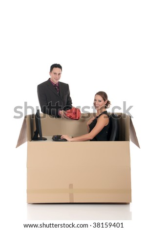 Young couple having a love chat session, chat box, cardboard box representing chat room.  Studio, white background