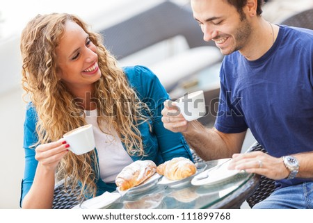 Young Couple Having a Traditional Italian Breakfast