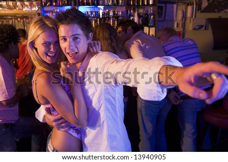 Young couple having fun at a nightclub