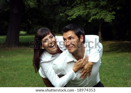 Young couple having fun in a park