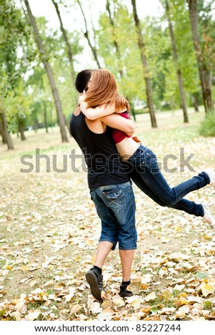 young couple having fun in park