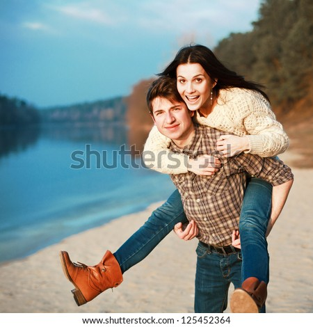 Young couple having fun on board of the river. Boy and girl smiling outdoor spring or summer portrait