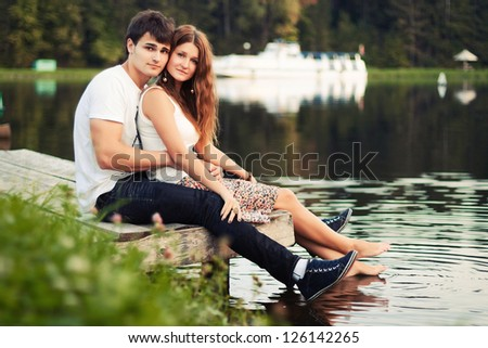 Young couple having fun on the river
