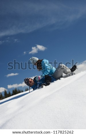Young couple having fun while playing snow fighting