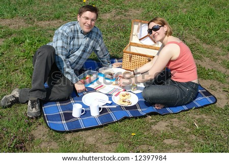 Young couple having picnic in the park