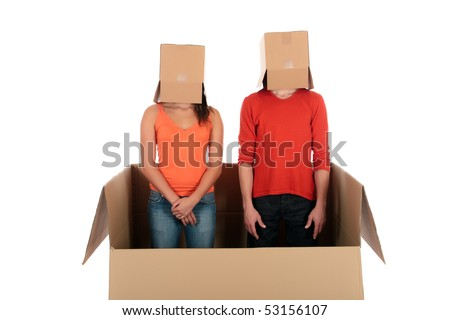 Young couple having quarrel during chat session, chat box, cardboard box representing chat room.  Studio, white background