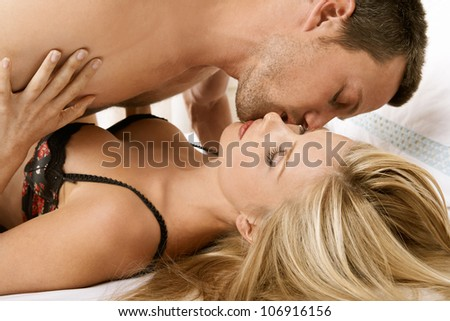 stock photo young couple having sex in bed kissing 106916156 stock photo : Young couple having sex in bed, kissing. Save to a lightbox ▼