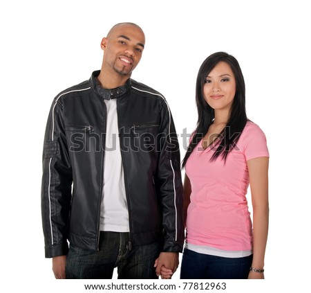 Young couple holding hands - African American guy with Asian girlfriend.