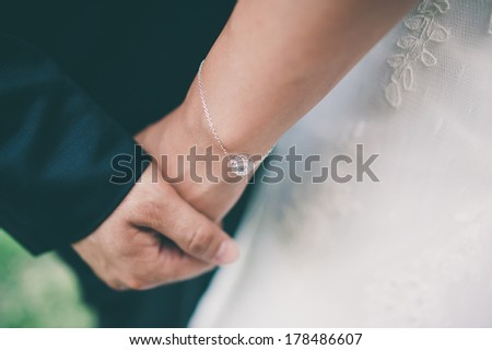 Young couple holding hands close-up  with retro filter effect #178486607