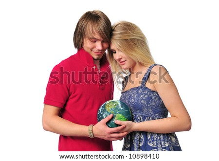 Young couple holding the earth isolated on a white background