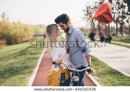 young couple hugging dating and kissing outdoor #646565938