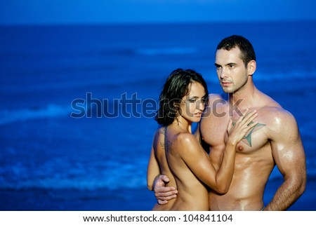 Young couple hugging in ocean