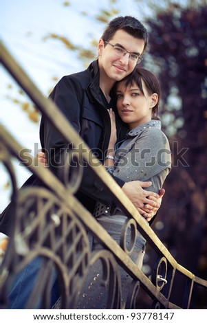 Young couple hugging in the autumn park