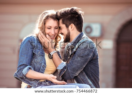 Young couple hugging in the city.Happy couple having great time together. - Shutterstock ID 754466872